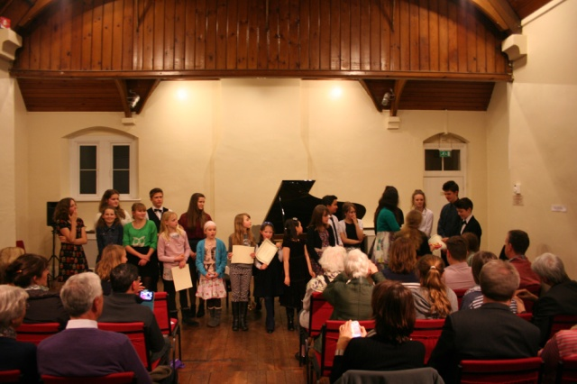 Certificates being awarded at the Spring Recital