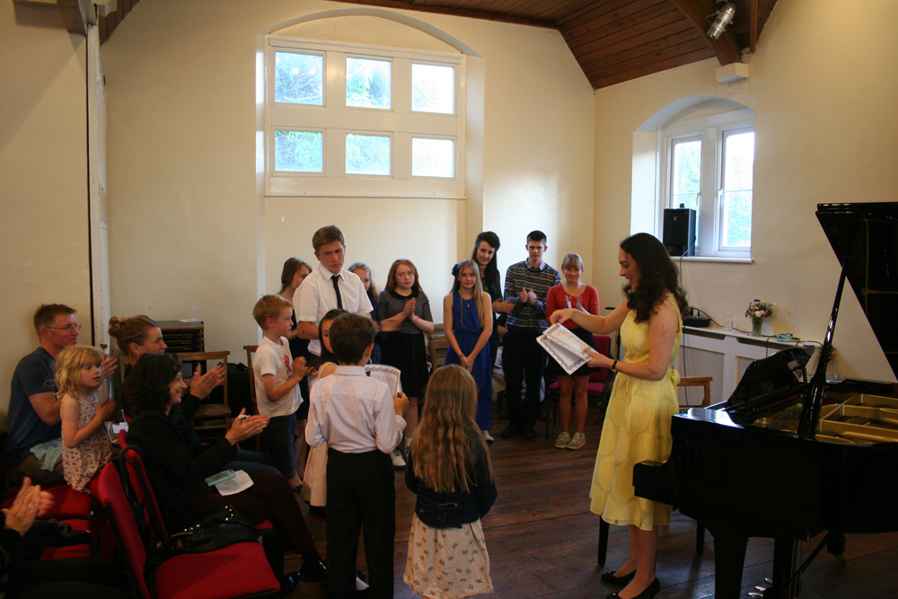 Certificates being presented at the Student Recital at St John's, Bath